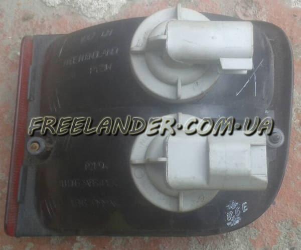 Задній лівий стоп (ліхтар) в бампер Freelander після 2004 XFB500190