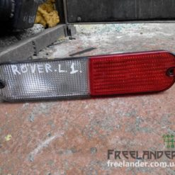 Ліхтар задній в бампер лівий для Land Rover Freelander XFB000290